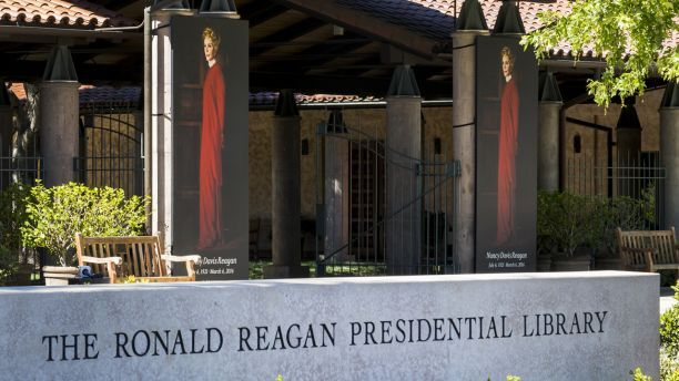 Obama takes heat for skipping Nancy Reagan's funeral for festival