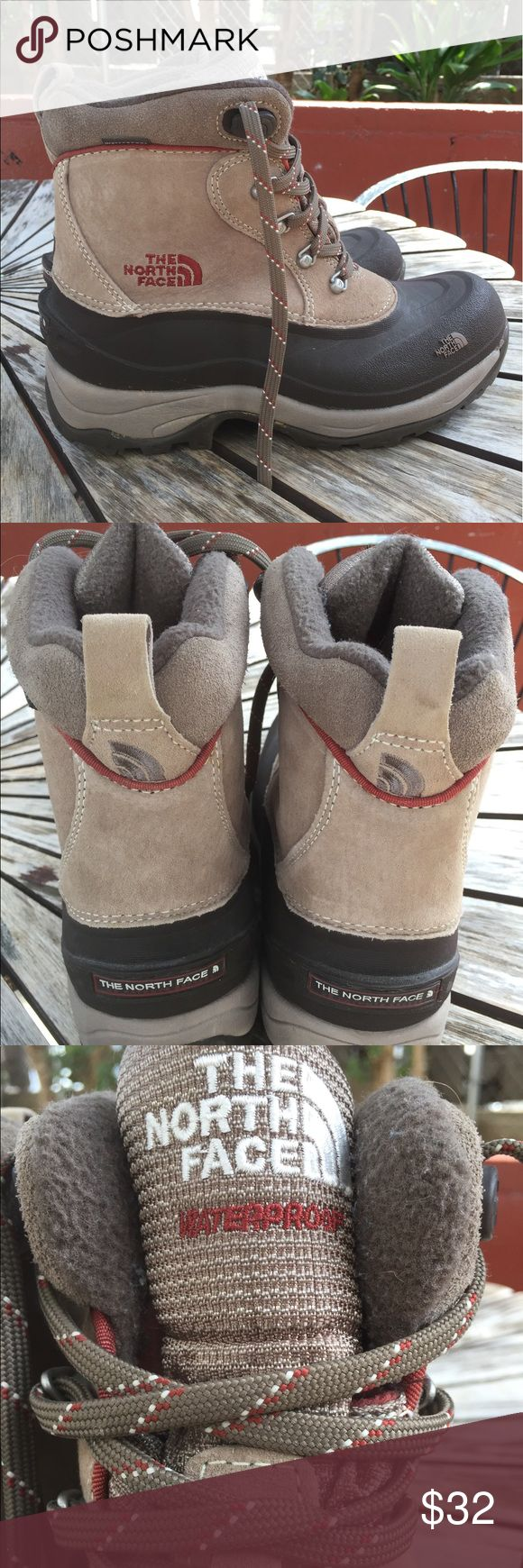 NORTH FACE Hiking boots. Gorgeous looking North Face wet weather hiking boots. They look  barely used and the tread shows no signs of wear. Taupe brown with brownish red and black accents The North Face Shoes Winter & Rain Boots