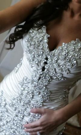 Pnina Tornai 4235 12: buy this dress for a fraction of the salon price on PreOwnedWeddingDresses.com