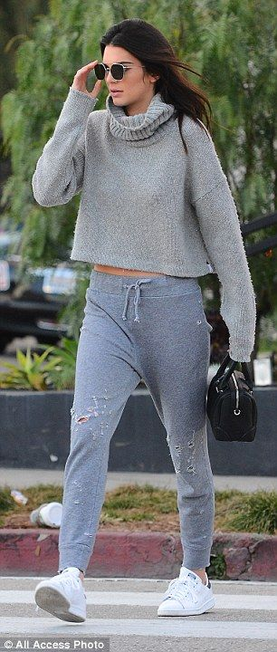 Always on the go: Kendall was ready for action in her midriff-revealing top and trendy tor...
