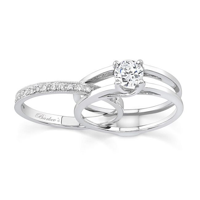 this classic designed interlocking diamond wedding set features a solitaire engagement ring sporting a prong set - The Wedding Ring