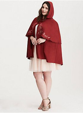 """This double layered burgundy ponte cape leaves the provincial life behind with rose, Lumièreand Mrs. Potts embroidery detailing the overlay. A button closure neck keeps the cape fitted, and open armholes lend versatility. The hood keeps you cozy as you adventure into the woods. Lace trim on overlay.<div><br></div><div><b>Model is 5'10"""", size 1<br></b><div><ul><li style=""""list-style-position: inside !important; list-style-type: disc !important"""">Size 0/1 measures 34"""" from..."""