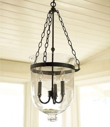 Hundi Lantern This beautiful inverted bell jar is made of handblown glass, which encases three candle sleeves. From Houzz Pottery Barn