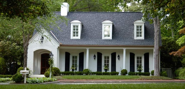 white brick house with black shutters