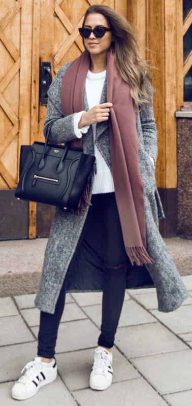 elegant winter style + Kenza Zouiten + dark denim jeans + retro style sneakers + maxi coat + oversized scarf + glamour  Coat: River Island, Jeans/Sunglasses: Asos, Shoes: Adidas, Sweater: Zara, Bag: Céline, Scarf: Acne.