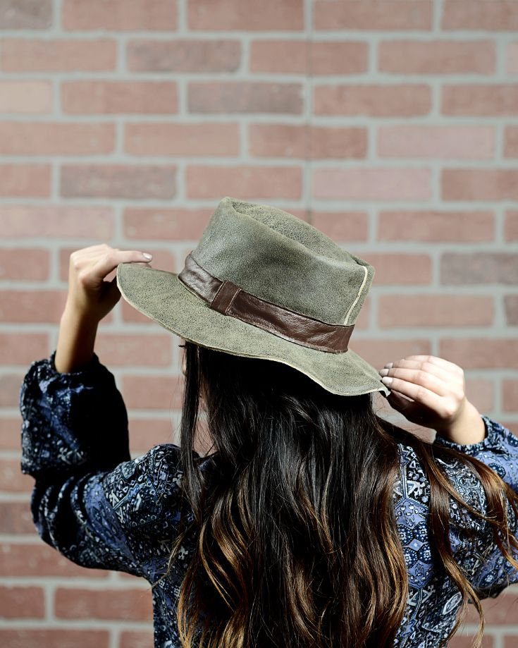 PALERMO features supple suede in a trendy olive color handmade in Italy. Flexible yet firm, this lovely hat transitions from work to play flawlessly.