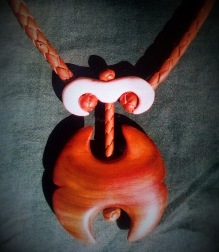 Pendant, Cherry wood, bone and leather Made by : Zoltan Feher