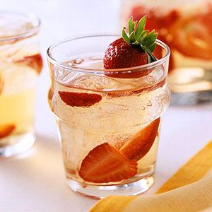 This fresh take on sangria combines strawberry schnapps and white wine to create a crisp, fruity summer drink.