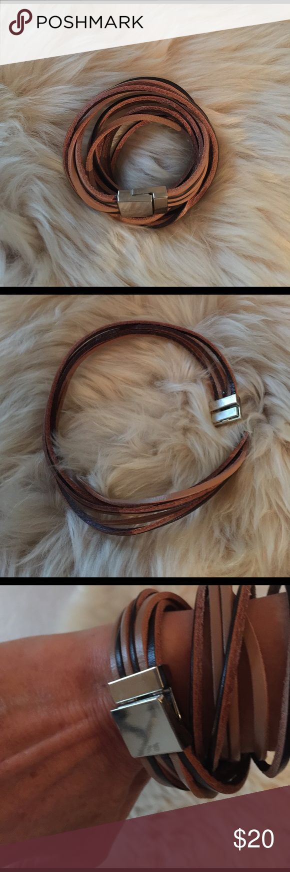 "BOHO Leather Strand Wrap Bracelet BOHO Leather Strand Wrap Bracelet With Magnetic Silver Closure. Light and dark strands of leather six strands total.  16""L and .75""W. Bracelet is intended to be wrapped around wrist twice.  Perfect for festival season!! Jewelry Bracelets"