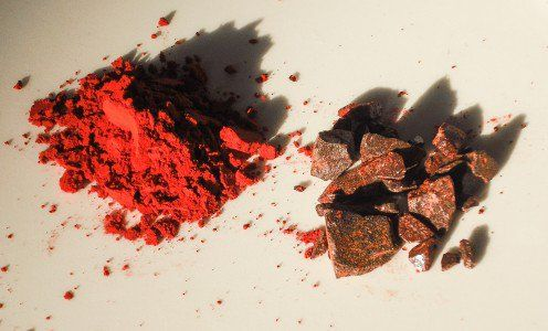Dragon's blood from Daemonorops draco; the powdered resin is on the left and the dry resin is on the right