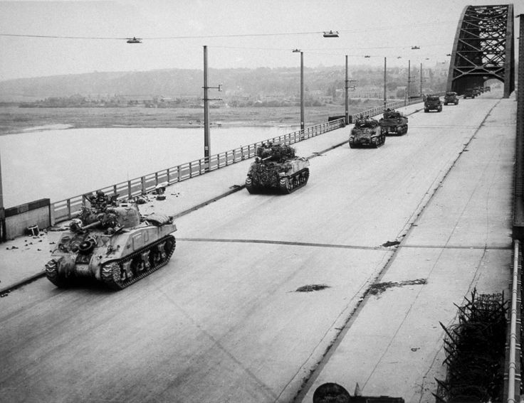 Operation Market Garden, September 1944 - British Shermans crossing the Nijmegen bridge after its capture by tthe US 82nd Airborne Division en route to relieve British paratroopers at Arnhem: German resistance up the single track, elevated road was severe and the operation was a serious allied reverse.