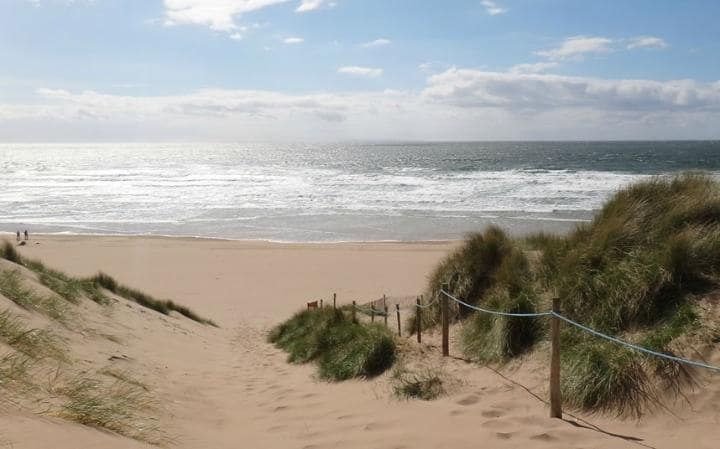 Woolacombe beach, devon, UK-Woolacombe is an epic, three-mile swathe of sand, which has oodles of space for surfers