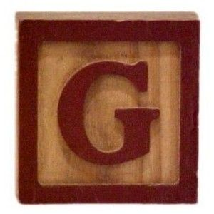 Child S Block Red G And Frame On Wood Grain Block G Jpg