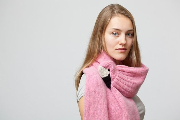 The soft, high-quality wool in the bird scarf makes it very nice to wear. In the flamingo's beak is a strong clip that serves as a clasp.   The scarf is knitted by a knitting machine and hand...
