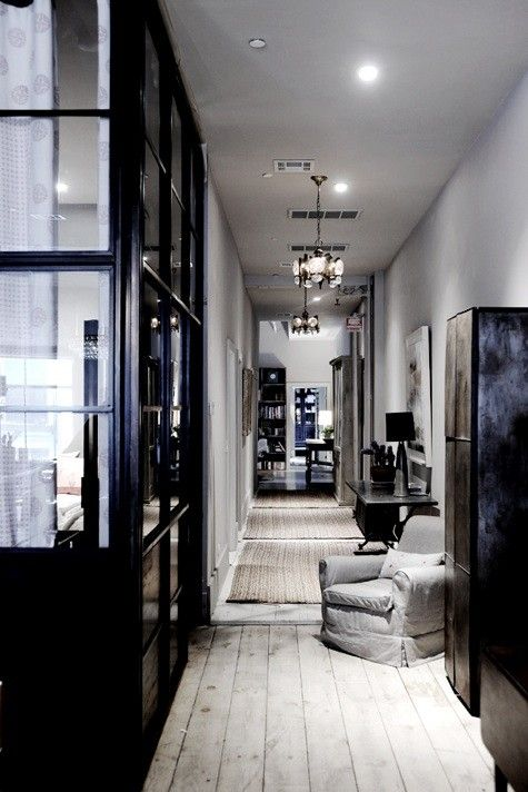 I love black stained wood and lots of glass with light floors.
