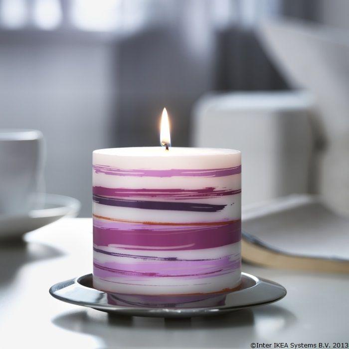 O lumânare colorată poate înveseli o zi mohorâtă.