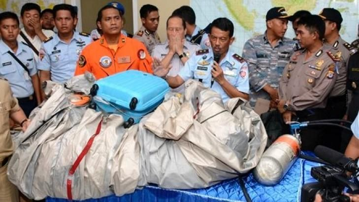 Airplane parts and a suitcase found floating on the water near the site where AirAsia flight 8501 di... - AP