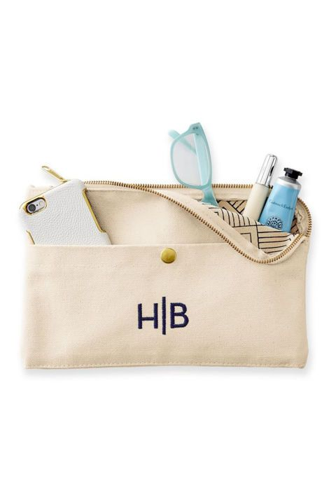 ($39, markandgraham.com)  Great for the woman on the go, this durable monogrammed canvas pouch has plenty of space for toiletries and every lipstick she might desire.