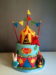 Circus themed birthday cake with Elmo, Nijntje en a cute little monkey