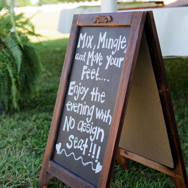 Most guests expect to have assigned seats at a wedding; if you're not doing a seating plan, clue in your loved ones with a sign located where they'd usually look for the escort cards.