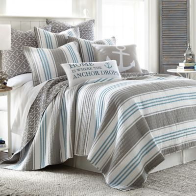 Transform your bedroom into a seaside retreat with the soothing Provincetown Reversible Quilt. Decked out in nautical stripes with an anchor print reverse, the soft blue and grey bedding creates a serene look and feel in any bedroom.