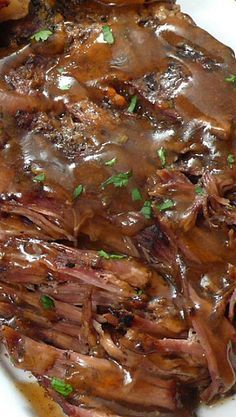"""Slow Cooker """"Melt in Your Mouth"""" Pot Roast ~ The meat is juicy and fall-apart tender. The vegetables are cooked just right and are full of flavor. The seasonings are simply spot on and the broth yields a fabulous gravy-like sauce that is divine when poured over everything prior to serving.:"""