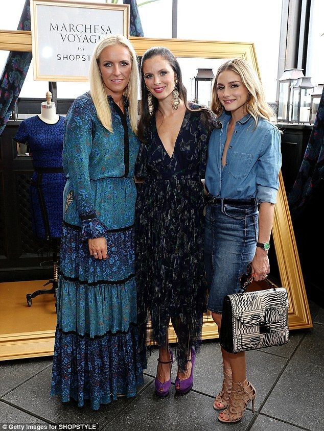 In the know: The beauty posed alongside the fashion line's two designers, Keren Craig and Georgina Chapman