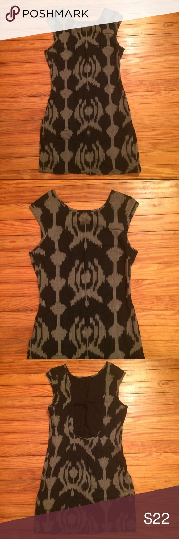 """Patterned mini dress Edgy ikat-printed cotton dress with low scoop back. Fitted shape with side zipper. Not stretchy. Black cotton lining. Never worn!  32"""" long 16"""" bust (flat) 14"""" waist (flat) 17"""" hips (flat) Urban Outfitters Dresses Mini"""