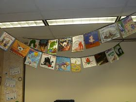 Book jackets hung as a pennant over the library.  I always take the jackets off because they get destroyed so quickly, so this is perfect. I can't wait to do this!