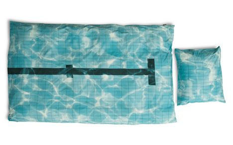Some people are so in love with the sport of swimming that they'd never leave the pool if they had to. If this sounds like you, Dutch bedding designers Snurk have the perfect duvet cover and pillowcase set. Called Pool, the set looks exactly like a sun-dappled swimming pool, complete with lane m ...