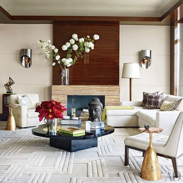 At a Manhattan home designed by Tony Ingrao and Randy Kemper, the living room features Maria Pergay sconces and Philippe Hiquily side tables   archdigest.com