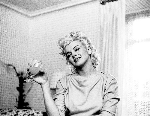 Marilyn Monroe photographed in her room at the Ambassador Hotel in NYC by Ed Feingersh in March 1955.