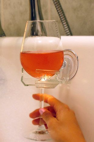 And the ultimate bathroom accessory: A cupholder for your bath wine or shower beer. | 23 Unexpected Things You Didn't Know Your Bathroom Needed
