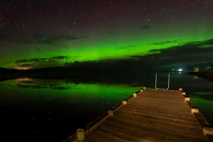 An Aurora Australis appears over the Huon River at Franklin, south-west of Hobart in Tasmania, October 8, 2012.