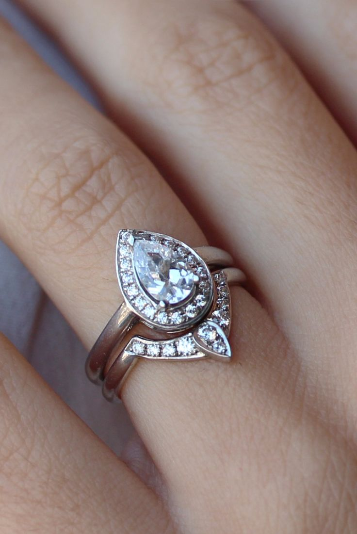 This is perfect. /// Pear Shaped Diamond Engagement Ring with Matching Side…
