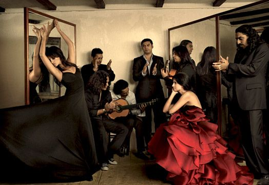 Penelope Cruz, Vogue, 2007.  The Cruz siblings share a flair for performance. In an OMO Norma Kamali ebony stretch dress, Mónica dances to the sounds of Diego el Cigala (far right) and his band while Penélope takes in the show. On Penélope (right): Marchesa cerise ombre silk-organza petal dress with black tulle corset. M+J Savitt gold hoop earrings.