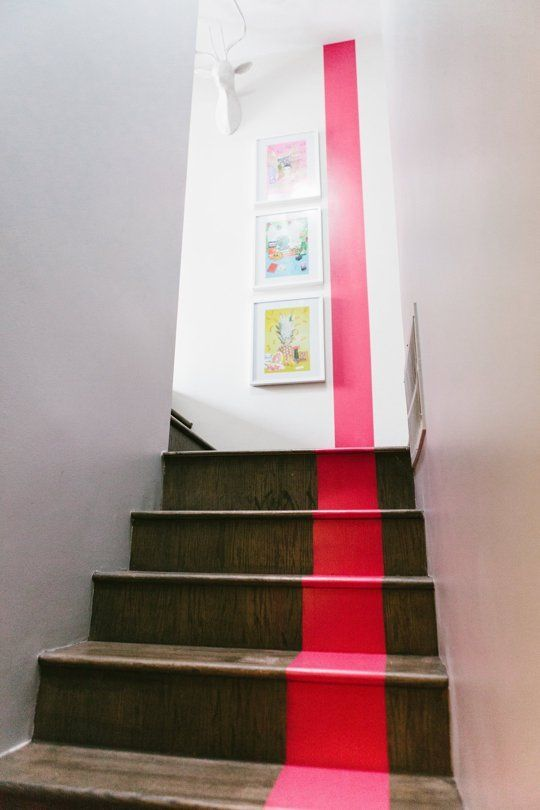 stripe in den to foyer? if have painted/stained concrete floors, that could look cool
