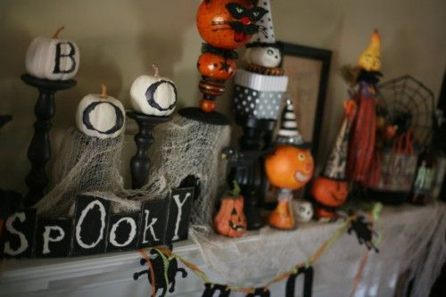"""mantel decorations: love the """"spooky"""" letters and """"BOO""""pumpkins on black candlesticks"""