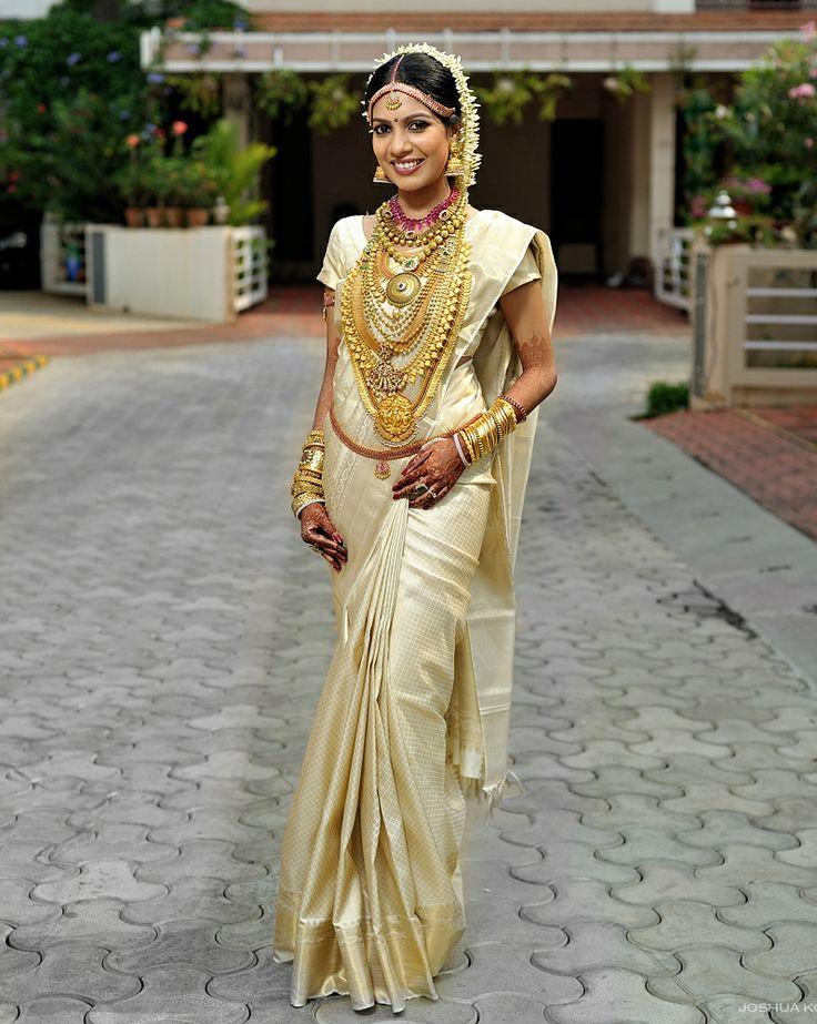 Elegant in cream and gold saree, south indian bride