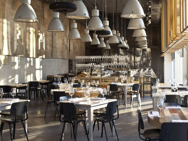 tel aviv restaurant with a cool industrial interior tables made by piet hein eek - Beaded Inset Restaurant Interior