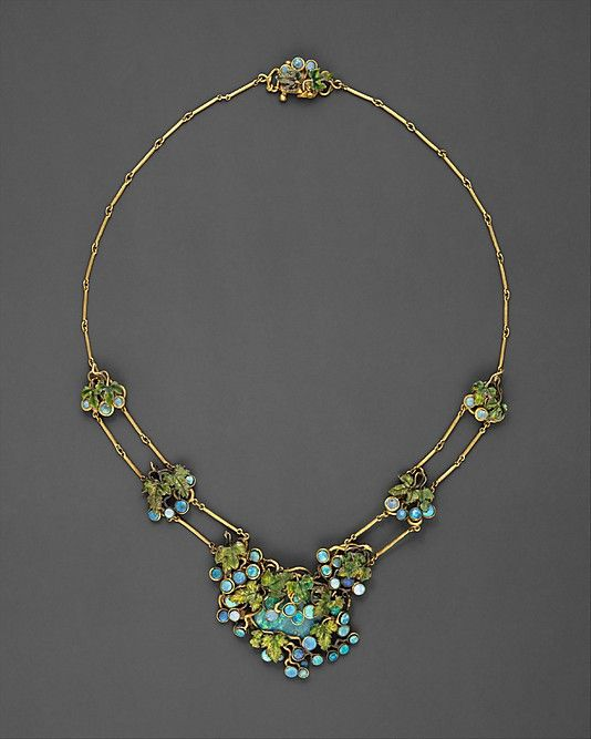 Louis Comfort Tiffany - one of the earliest known examples of jewelry designed by Tiffany. Black opals represent the clusters of fruit, and finely executed enameling in shades of green on gold forms the delicate leaves. This necklace was among the twenty-seven pieces that Tiffany made for the Louisiana Purchase Exposition in Saint Louis in 1904. Believed to have been presented to his nurse and later companion, Sarah E. Hanley.