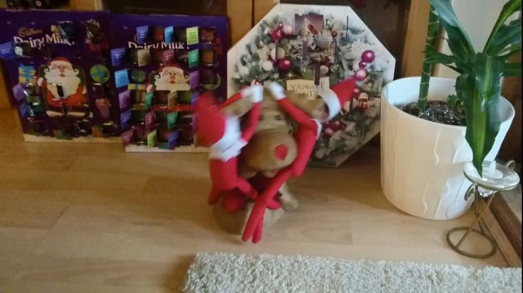 Elf on the Shelf Day 21: spinning on Rudolph