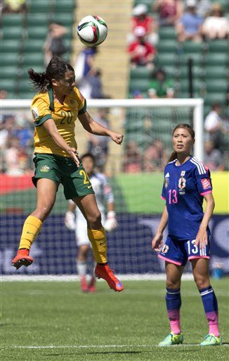 Japan's Rumi Utsugi (13) watches as Australia's Samantha Kerr (20) heads the ball during second half FIFA Women's World Cup quarter-final action in Edmonton, Alberta, Canada, Saturday Jun 27, 2015. (Jason Franson/The Canadian Press via AP) MANDATORY CREDIT ▼28Jun2015AP|Iwabuchi lifts Japan to semis with 1-0 win over Australia http://bigstory.ap.org/article/b09f77ed7c474dafb4897a02e6d4e3d6 #2015_FIFA_Womens_World_Cup #Quarterfinal_Australia_vs_Japan