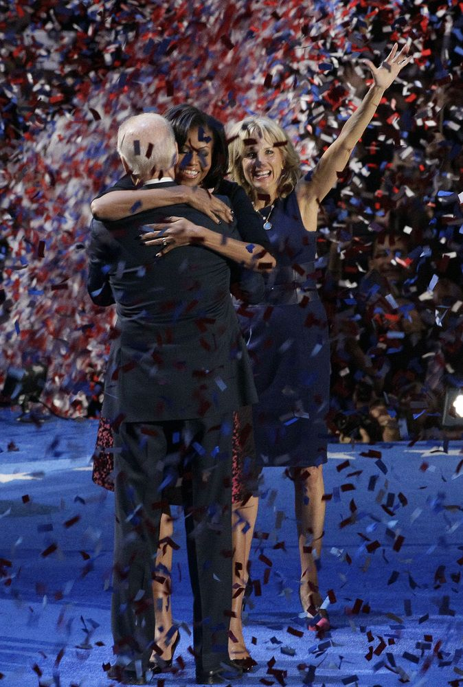 Jill Biden watches as Vice President Joe Biden is hugged by first lady Michelle Obama at President Barack Obama's election night party Wednesday, Nov. 7, 2012, in Chicago. President Obama defeated Republican challenger former Massachusetts Gov. Mitt Romney. (AP Photo/Nam Y. Huh)