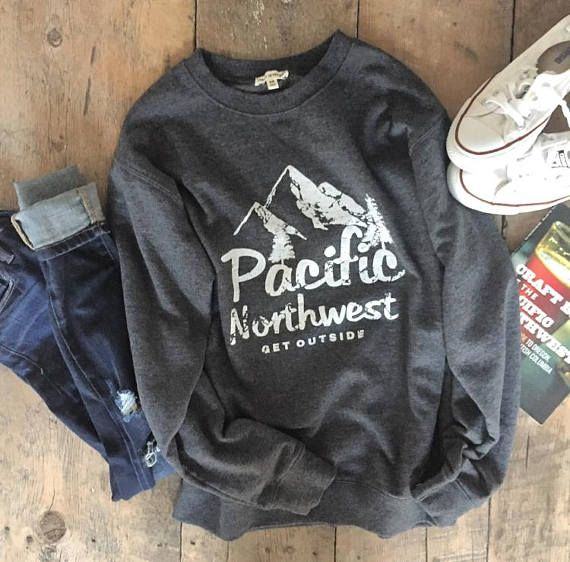   Pacific Northwest. Get Outside   The Great Outdoors are calling.......DRESS THE PART in our super-soft and cozy crew neck sweatshirt! The Details: Relaxed fit Crew-Neck // Rugged design with distressed detail for a vintage, well-loved look. Sure to be your new favorite pullover. The