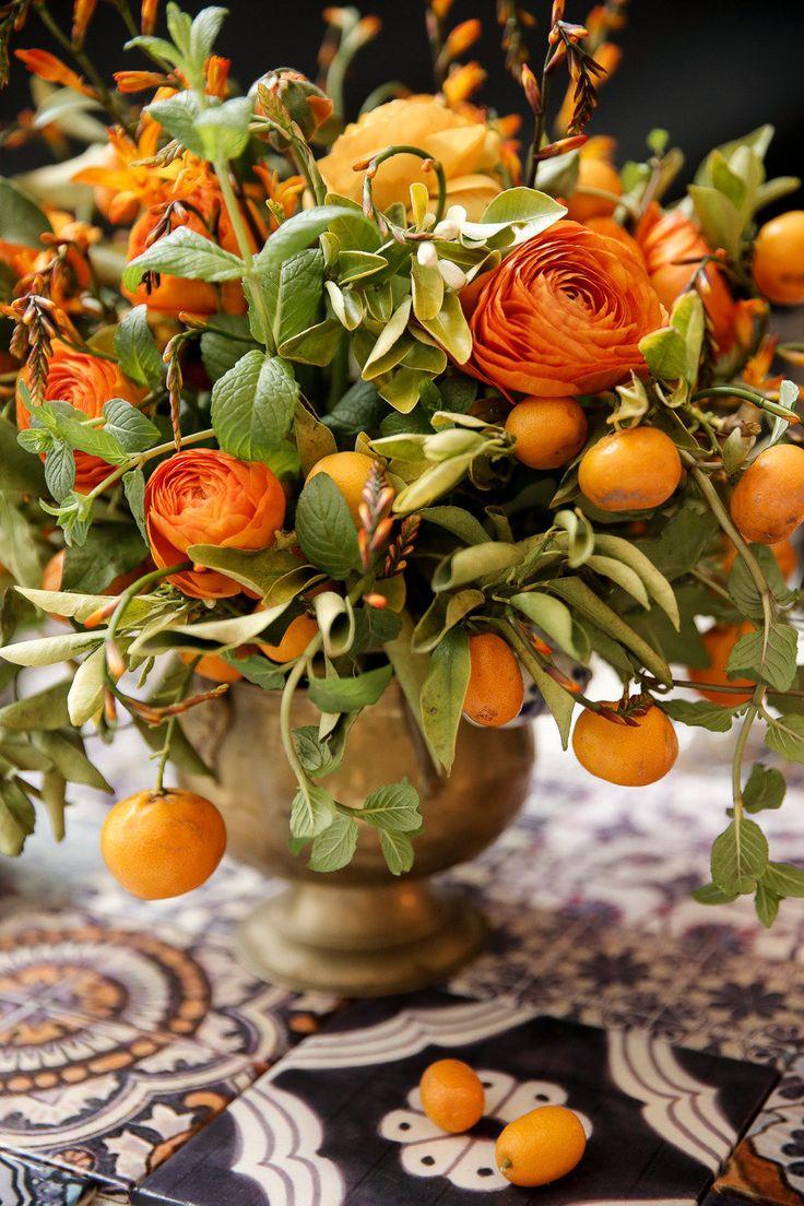 Autumn Centerpiece which mixes Ranunculus with Citrus Fruits