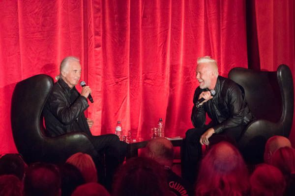 I'm in the front row listening to Jimmy Page and Jeff Woods