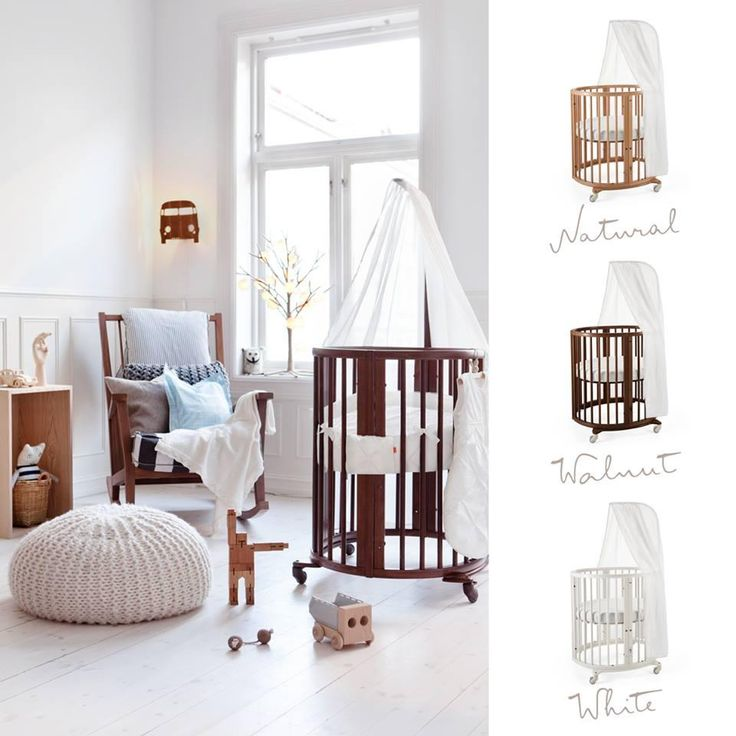 oval-shaped mini crib that converts into a full-size crib too - so unique and beautiful