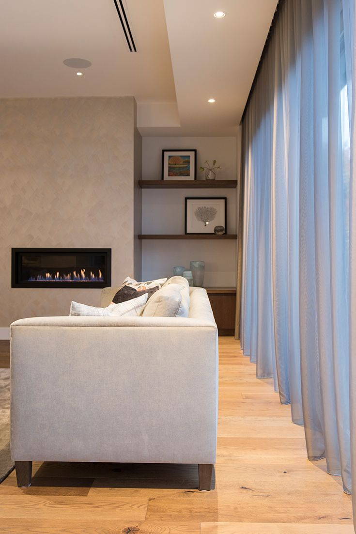 Living room sheer curtains soften and provide warmth to the space. Designed and styled by Emme Designs.
