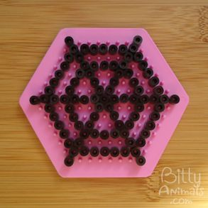 Steps for making spider web design out of Perler Beads